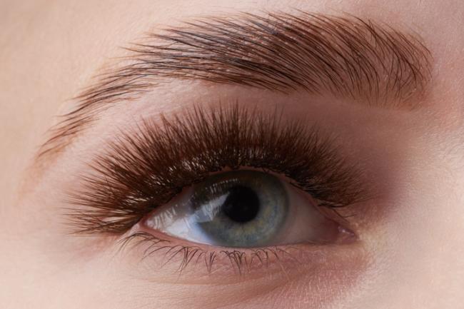 Beautiful macro photography of a woman's eye with extreme make-u