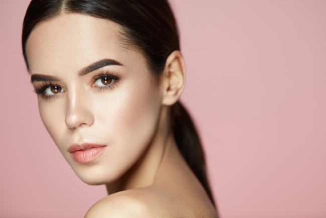 Beauty Makeup. Closeup Of Gorgeous Woman Face With Soft Skin