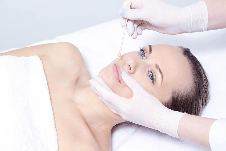Cosmetic procedure for hair removal. Bright skin. Beauty and health